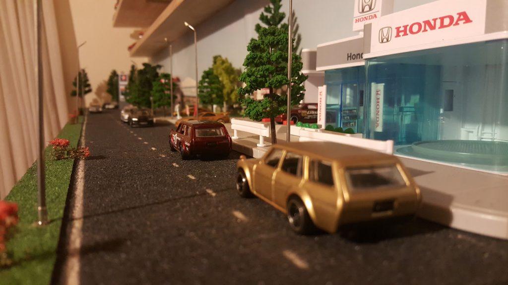 a diecast world in a 1:64 scale diorama
