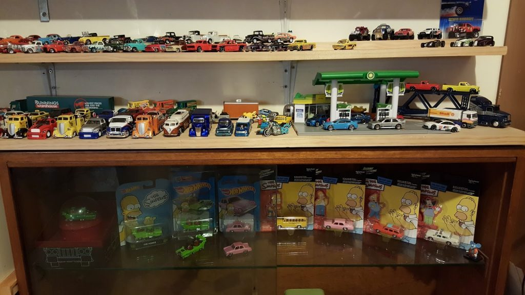 collection of hotwheels and diecast simpsons cars