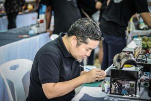 Pisut Masanong hard at work at the Thai Custom Diecast Model Festival